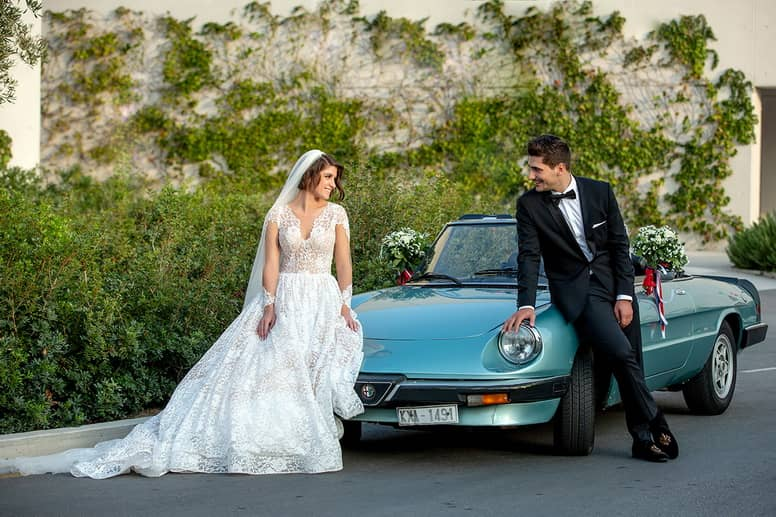 Athens Greek Wedding Couple Posing on wedding car