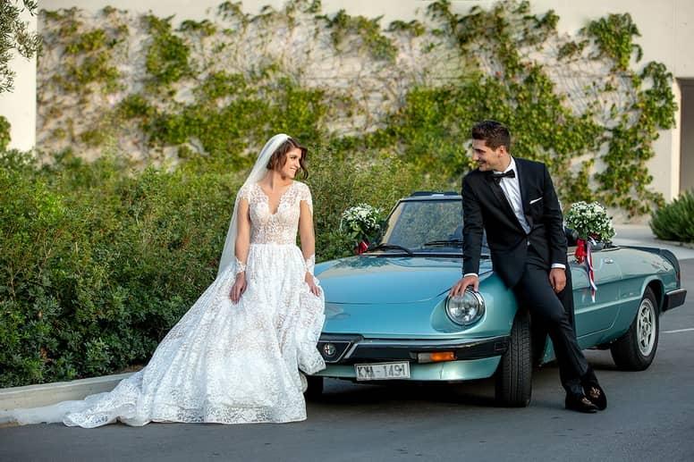 Athens Greek Wedding Couple Posing on wedding car